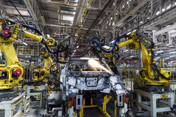 Robotic arms assemble an SUV on the production line at Mahindra & Mahindra's facility in Chakan, Maharashtra, India, in April. The company is India's largest SUV maker. Bloomberg photo by Udit Kulshrestha