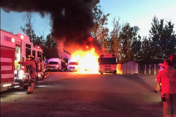 A weekend fire started by a fuel thief destroyed all three buses operated by Wasilla Lake Christian School on Saturday, June 3, 2018, officials there say. (Photo courtesy Wasilla Lake Christian School via Facebook)