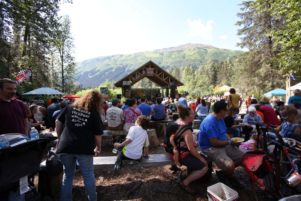 Festivalgoers gather near the music and food stands at the 40th Annual Girdwood Forest Fair on July 3, 2015. (Shelby Lum / ADN)