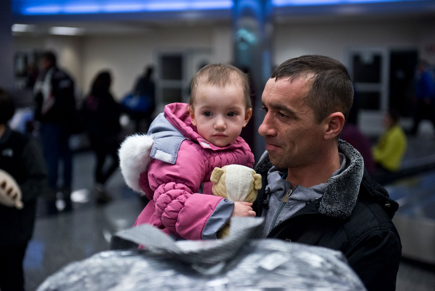 Two-year-old Diana Trashchuk and her father, Mykhailo Trashchuk, are two of four refugees who arrived in Anchorage on Feb. 16 from Ukraine. The group was assisted in Alaska by Refugee Assistance and Immigration Services. (Marc Lester / Alaska Dispatch News)
