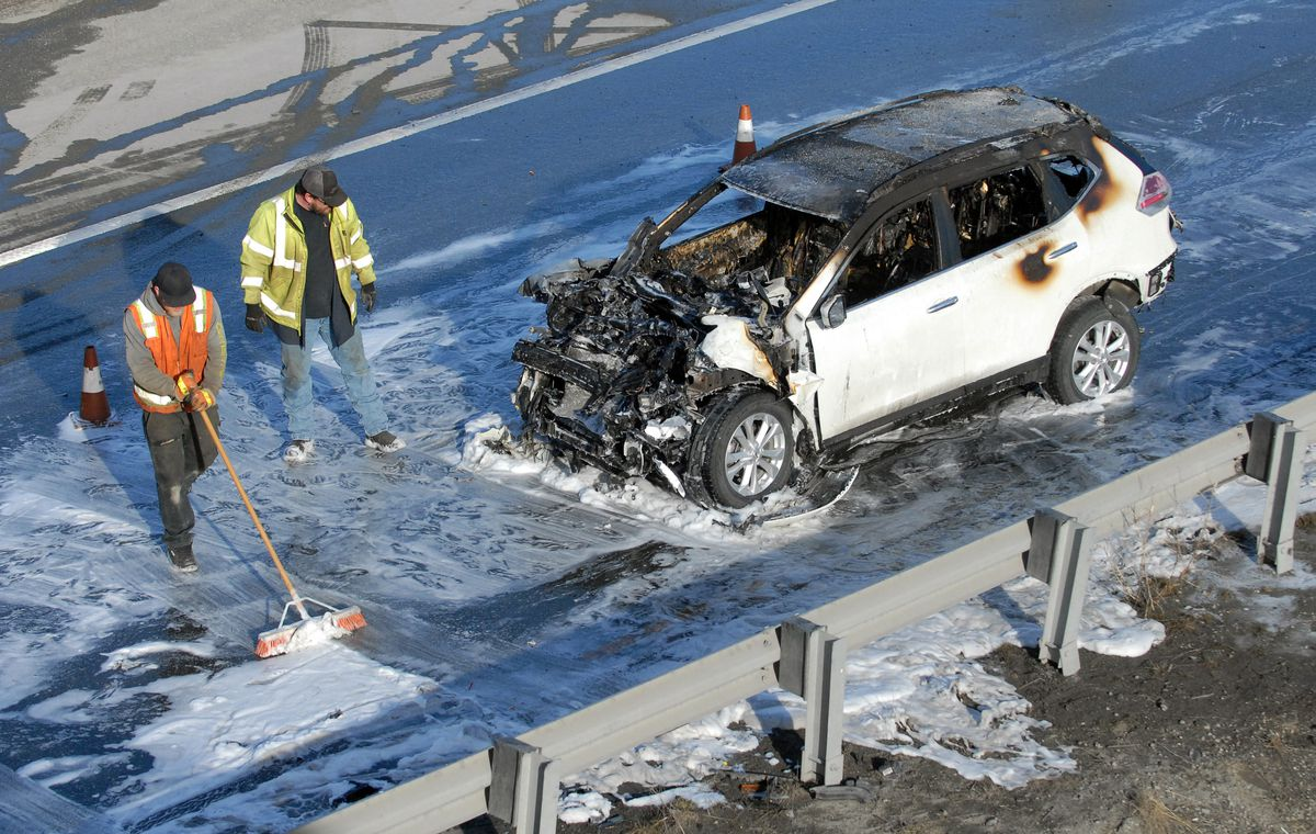 Workers clean up the scene of a multi-vehicle crash on the Glenn Highway near the Eagle River exit on Thursday, April 25, 2019. Police said the six-vehicle crash caused only minor injuries. (Matt Tunseth / Chugiak-Eagle River Star)