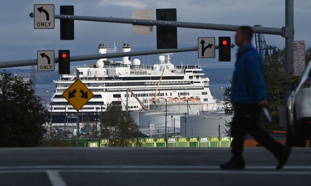 Sunlight illuminates the Holland America Line cruise ship Amsterdam moored at the Port of Alaska on Monday, Sept. 16, 2019, as viewed from 4th Avenue and E Street in downtown Anchorage. (Bill Roth / ADN)