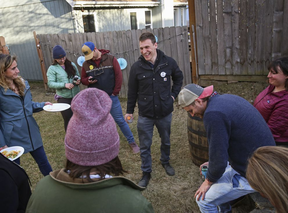 Mayoral candidate Forrest Dunbar, center, talks with friends and members of his campaign while waiting on election results in Anchorage on Tuesday, May 11, 2021. (Emily Mesner / ADN)