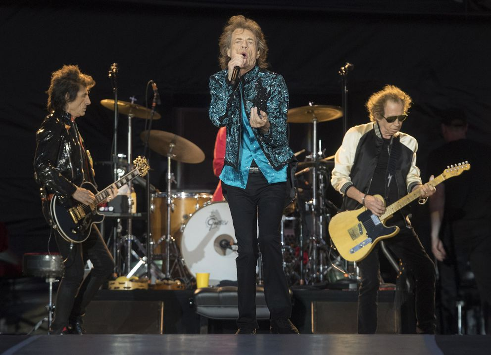 FILE - Mick Jagger, center, Keith Richards, right, and Ronnie Wood, left, of the Rolling Stones perform during the 'No Filter ' tour in Oro-Medonte, Ontario, on June 29, 2019. The group is among several musicians who are objecting to their songs being used at President Donald Trump's campaign rallies. (Fred Thornhill/The Canadian Press via AP, File)