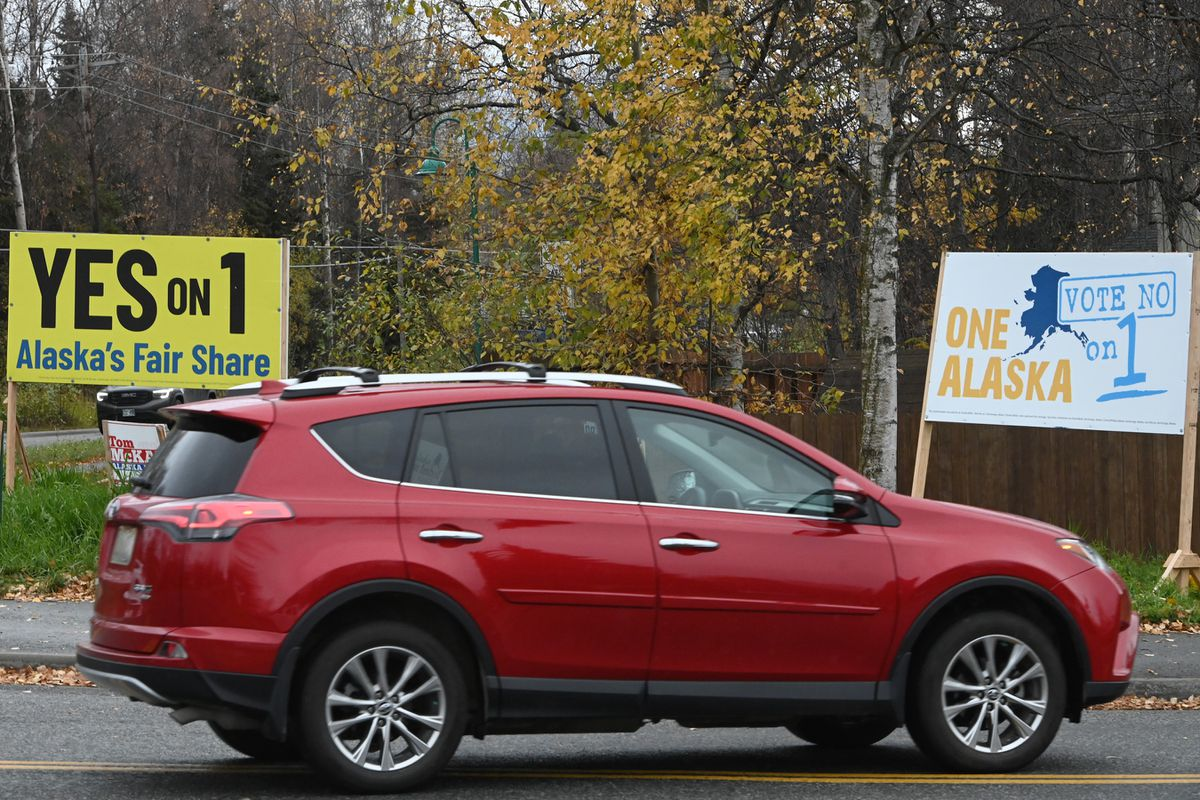 Dueling Ballot Measure 1 campaign signs in South Anchorage urge voters to decide during the General Election on Nov. 3 if the state should boost oil production taxes on the North Slope. (Bill Roth / ADN)