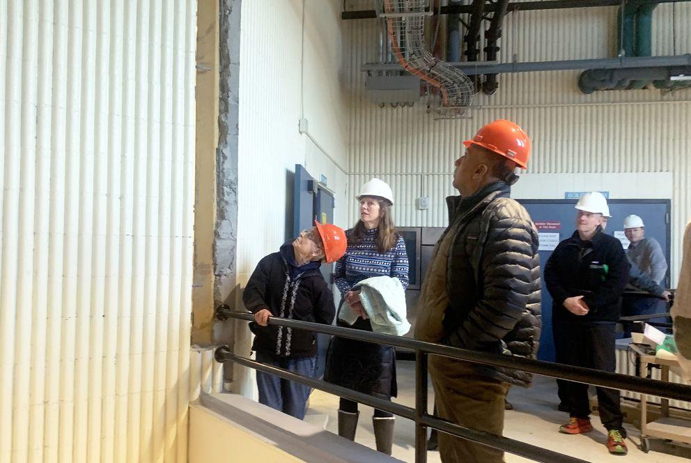 Community members inspect damage to a wall at Gruening Middle School. (Matt Tunseth / ADN)