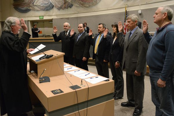 Alaska Supreme Court Chief Justice Craig Stowers swears in Anchorage Assembly members Fred Dyson, Felix Rivera, Christopher Constant, Suzanne LaFrance, Pete Peterson and Tim Steele at the Loussac Library in Anchorage, Alaska, on Tuesday April 18, 2017. (Bob Hallinen / Alaska Dispatch News)