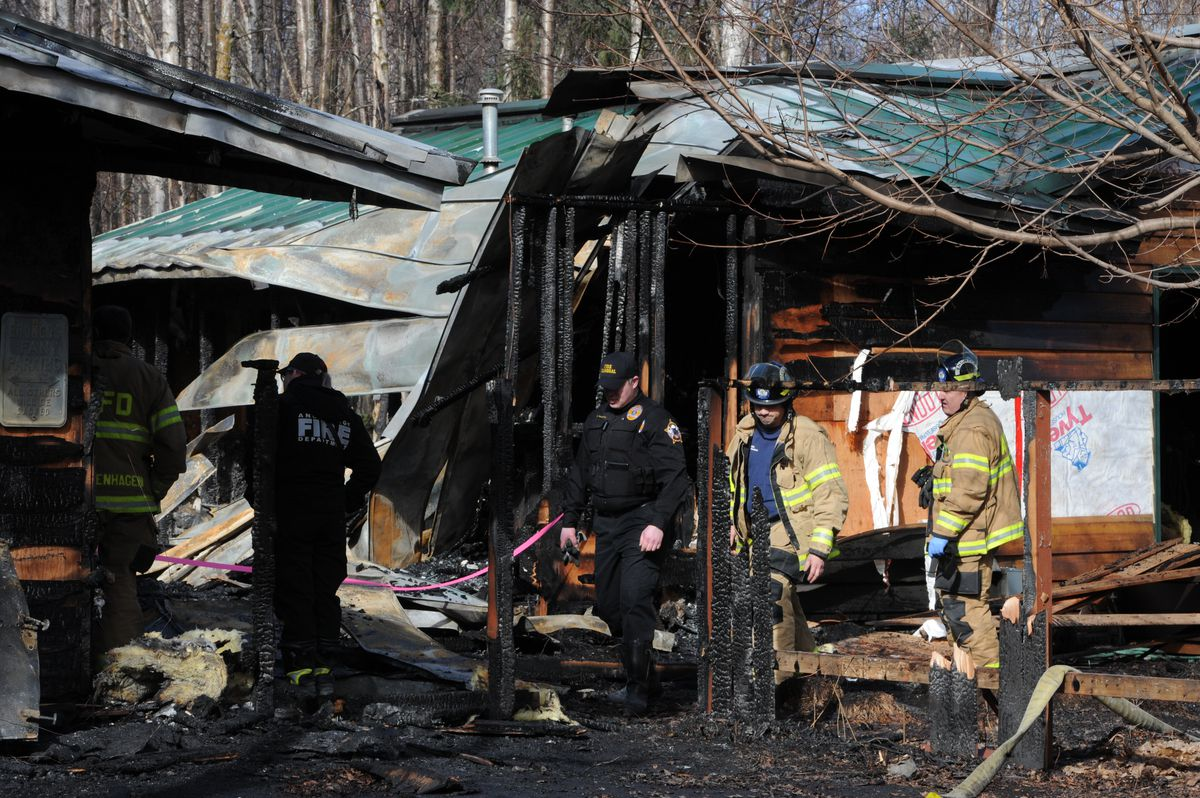 Fire investigators on scene of a fatal early morning fire that destroyed a home near Sand Lake and claimed the life of one person on Sunday, April 7, 2019. (Bill Roth / ADN)