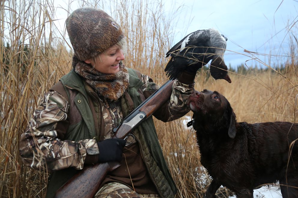 Cheyenne is excited after retrieving a goldeneye hen last weekend. (Photo by Steve Meyer)