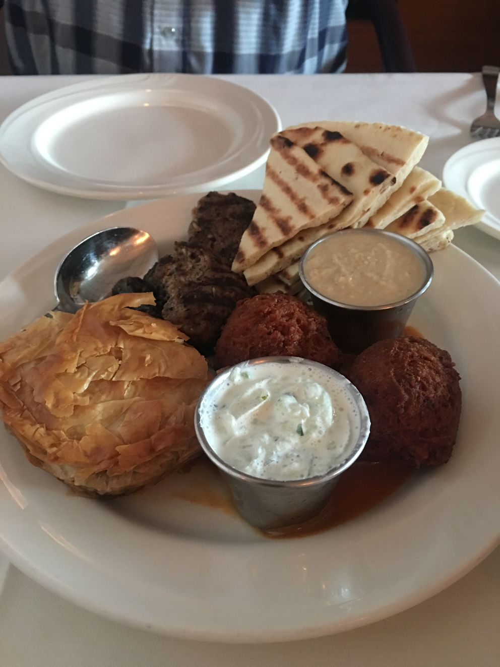 The sampler plate at Aladdin's includes falafel, hummus, tzatziki, spanakopita, kefta and dolma. (Photo by Mara Severin)