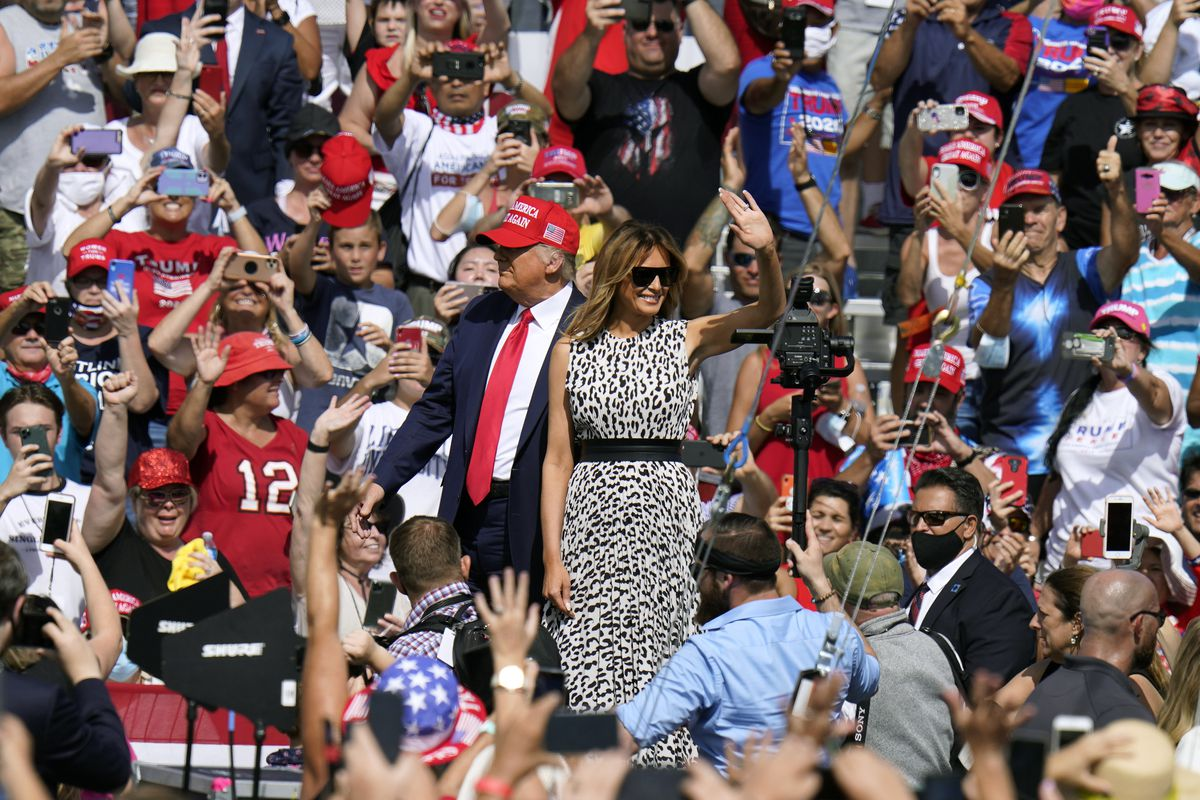 President Donald Trump and first lady Melania Trump arrive for a campaign rally Thursday, Oct. 29, 2020, in Tampa, Fla. Few in attendance were wearing masks on the hot and muggy day. (AP Photo/Chris O'Meara)