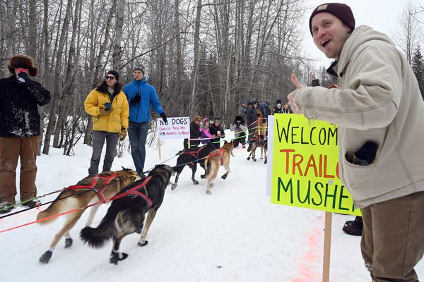 Luke Richards, of Anchorage, cheers on a musher at the Trailgate party along the route of the Iditarod ceremonial start, March 7, 2020. (Anne Raup / ADN)