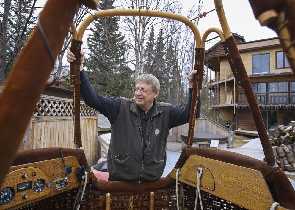 Jim Rogina stands with one of his hot air balloon baskets outside his home in Anchorage on Thursday, April 29, 2021. (Emily Mesner / ADN)