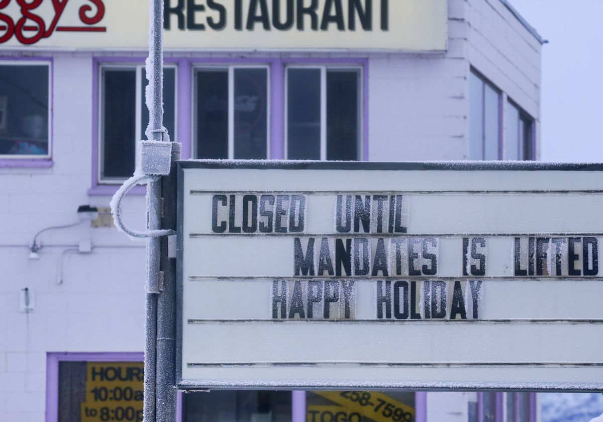 A sign alerts customers that Peggy's Restaurant will remain closed until pandemic mandates in Anchorage are lifted, photographed on Sunday, January 3, 2021. (Emily Mesner / ADN)