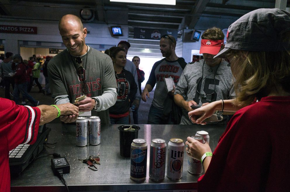 Customers purchase beer during a college football game between Ohio State University and Rutgers University in Columbus, Ohio, on Oct. 1. (Brittany Greeson/The New York Times)