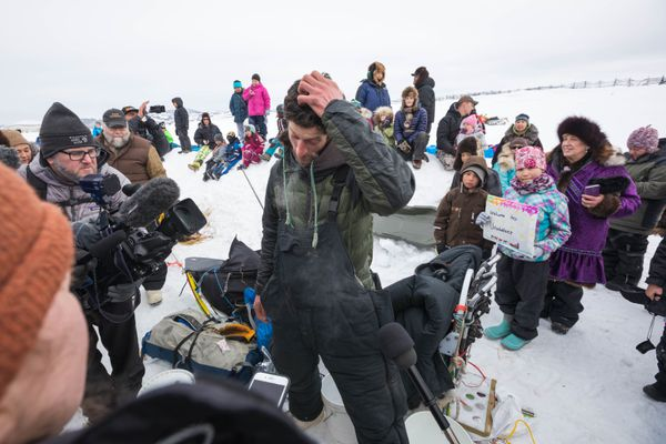 Nicolas Petit talks to the media after his arrival in Unalakleet on Sunday, March 11, 2018. (Loren Holmes / ADN)