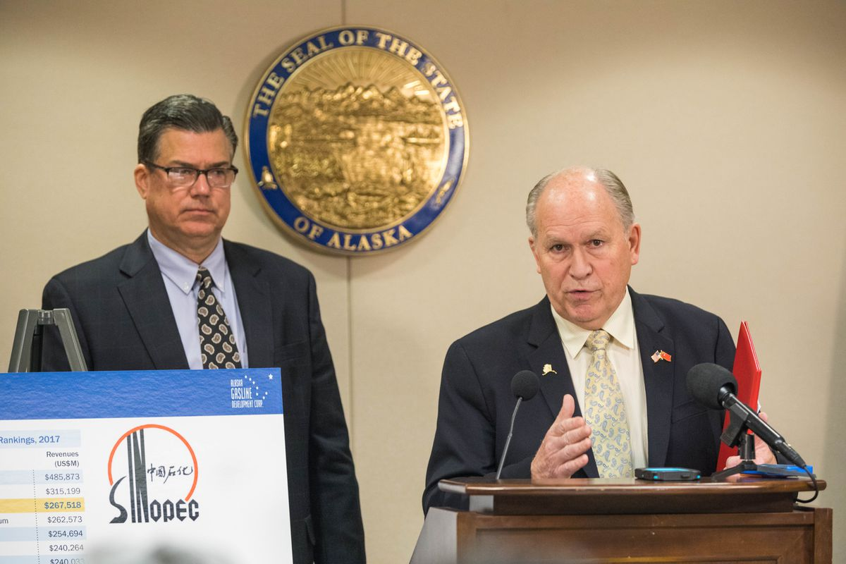 Alaska Gasline DevelopmentCorp. president Keith Meyer, left, and Alaska Gov. Bill Walker speak at a press conference about the state's liquefied natural gas joint development agreement with China on Nov. 21, 2017. (Loren Holmes / ADN)