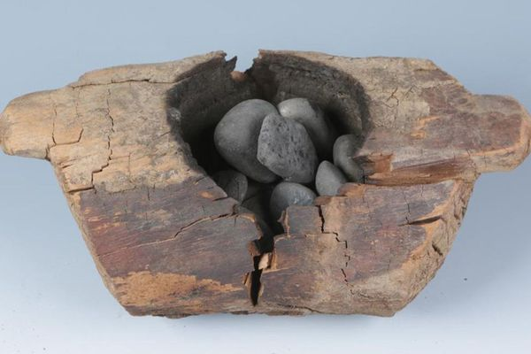 A typical brazier and burned stones that were used in parts of China 2,500 years ago to smoke marijuana. (Xinhua Wu/Science Advances/TNS)