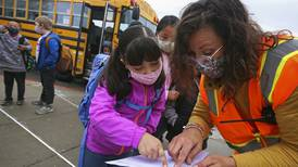 Masks, hand sanitizer and first-day excitement  — thousands of students across Anchorage go back to school in-person