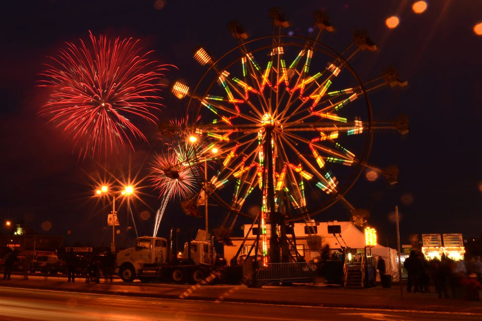 The Rondy fireworks explode in the sky over the Ferris wheel at the Rondy Carnival in downtown Anchorage on the first weekend of the Anchorage Fur Rondy on Saturday, February 28, 2015. Fur Rondy continues through March 8, 2015. (Bob Hallinen / ADN archive)