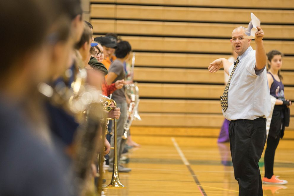 Dr. Jamin Burton leads a rehearsal with Colony High School's marching band, Thee Northern Sound. (Loren Holmes / Alaska Dispatch News)
