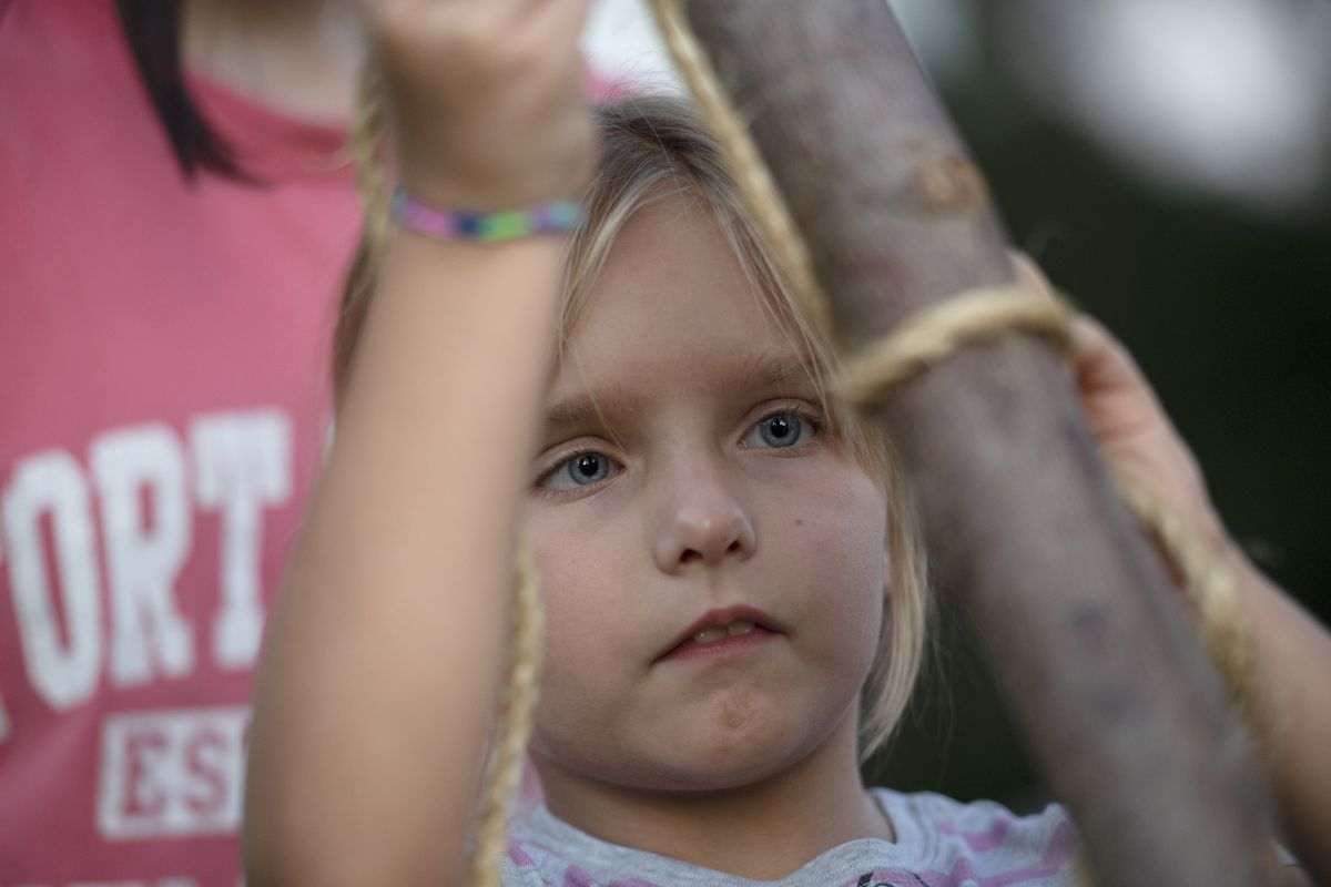 Charlotte Young, 9, of Troop 270 works on a knot. The inclusion of girls in Boy Scout programs has boosted numbers in the Washington, D.C., area. (Washington Post photo by Marvin Joseph)