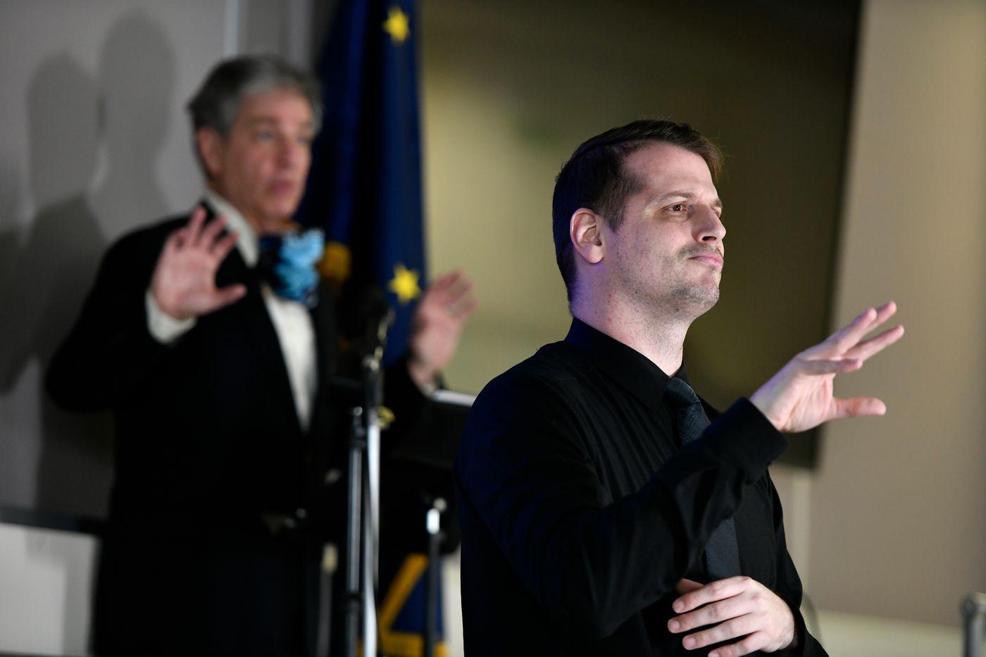 Sign language interpreter Byron Jensen interprets statements by Anchorage Mayor Ethan Berkowitz during a coronavirus briefing on April 8, 2020. (Marc Lester / ADN)