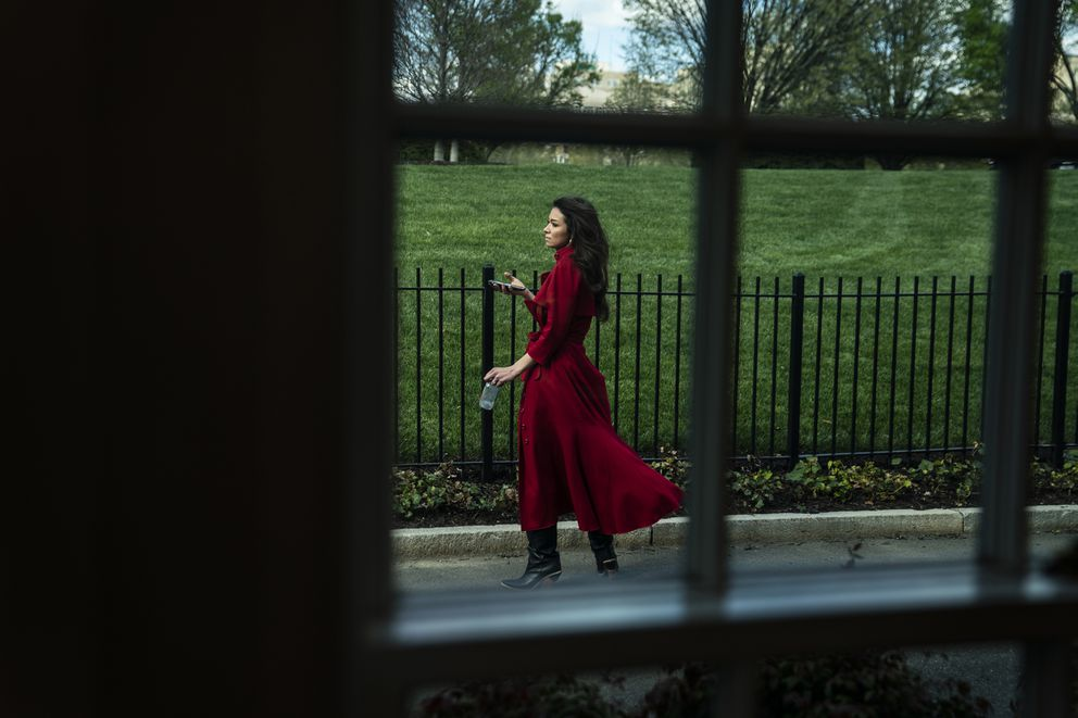 Chanel Rion, chief White House correspondent for One America News, waits ahead of a coronavirus briefing at the White House on April 2. Washington Post photo by Jabin Botsford