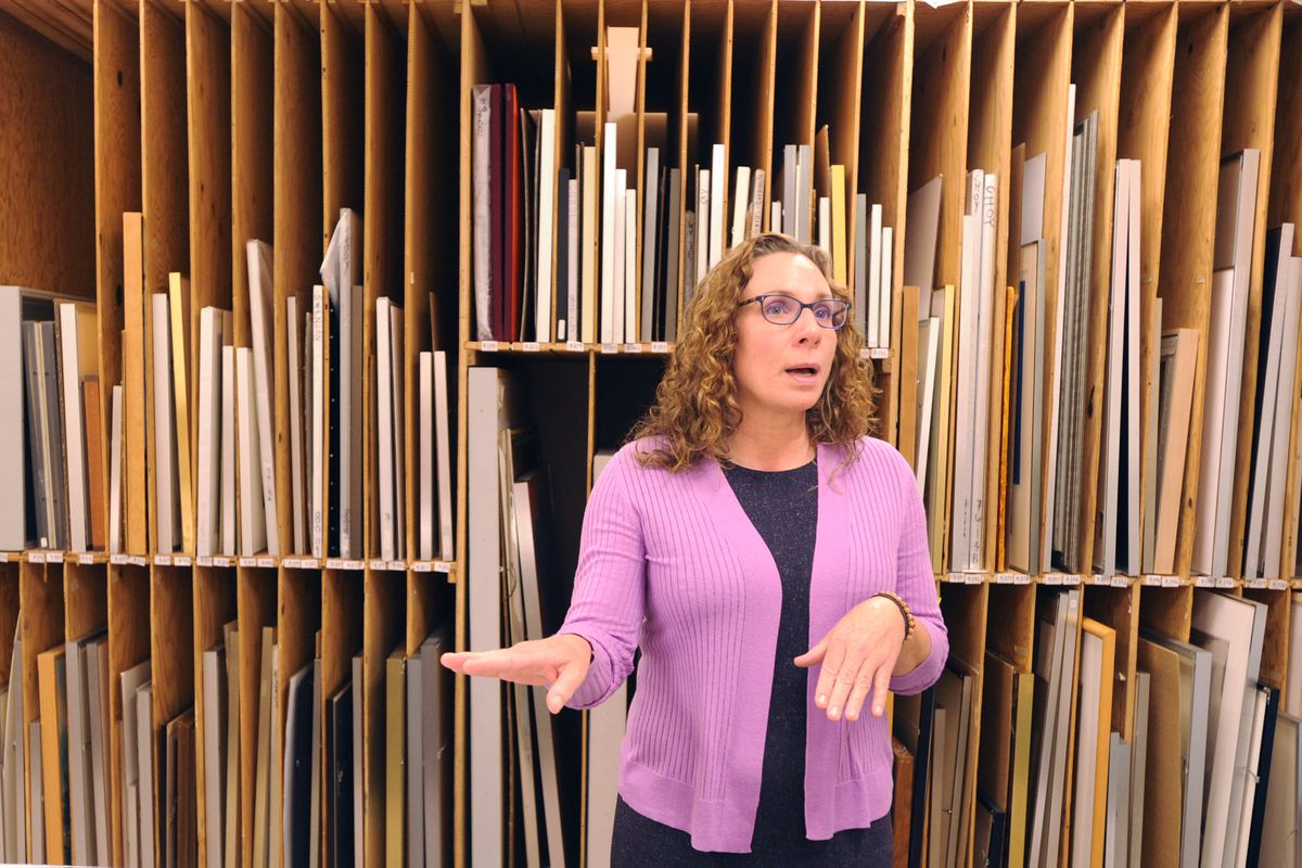 Andrea Noble-Pelant, Executive Director of the Alaska State Council on the Arts, talks about the Contemporary Art Bank, Tuesday, July 2, 2019. The bank loans out pieces of art by living Alaskan artists. (Anne Raup / ADN)