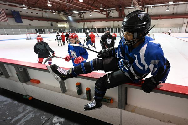 Tavian Mukaabya, 12, hops over the boards during a line shift at the Save the Seawolves hockey clinic at the Dempsey Anderson Ice Arena on Sunday, April 25, 2021. (Bill Roth / ADN)