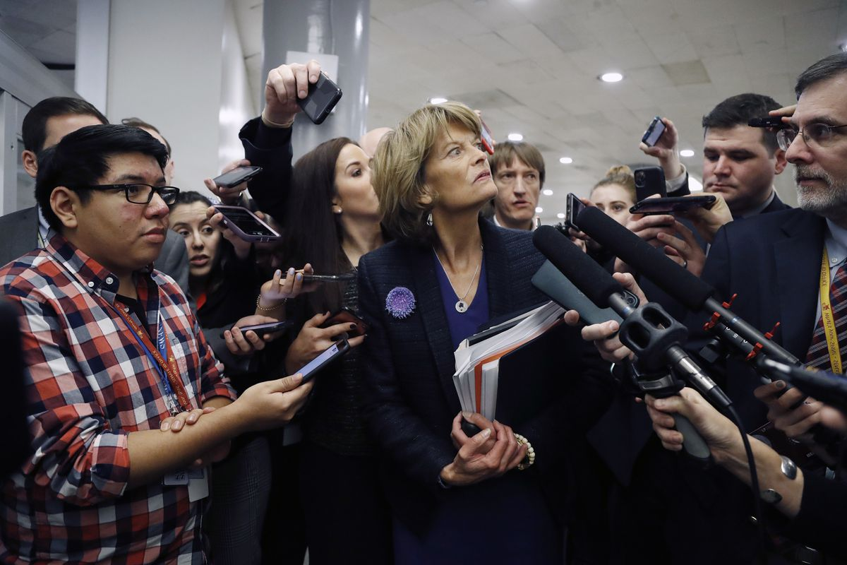 Sen. Lisa Murkowski, R-Alaska, talks with reporters as in the basement of the U.S. Capitol in Washington, Thursday, Jan. 30, 2020, while leaving at the end of a session in the impeachment trial of President Donald Trump on charges of abuse of power and obstruction of Congress. (AP Photo/Julio Cortez)