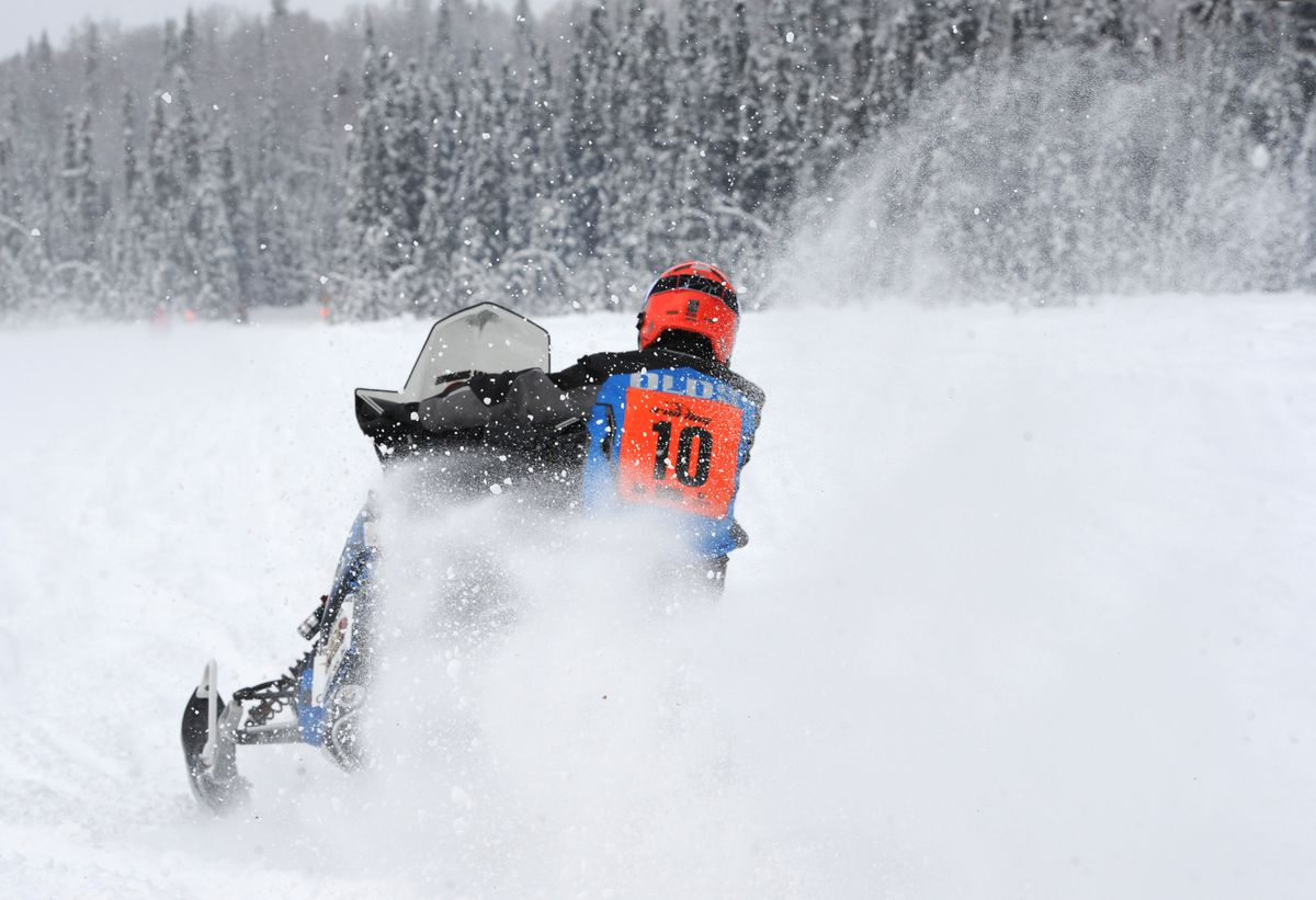 Iron Dog snowmachines throw up snow that can make it tough to see, especially when it gets windy. (Bill Roth / Alaska Dispatch News)