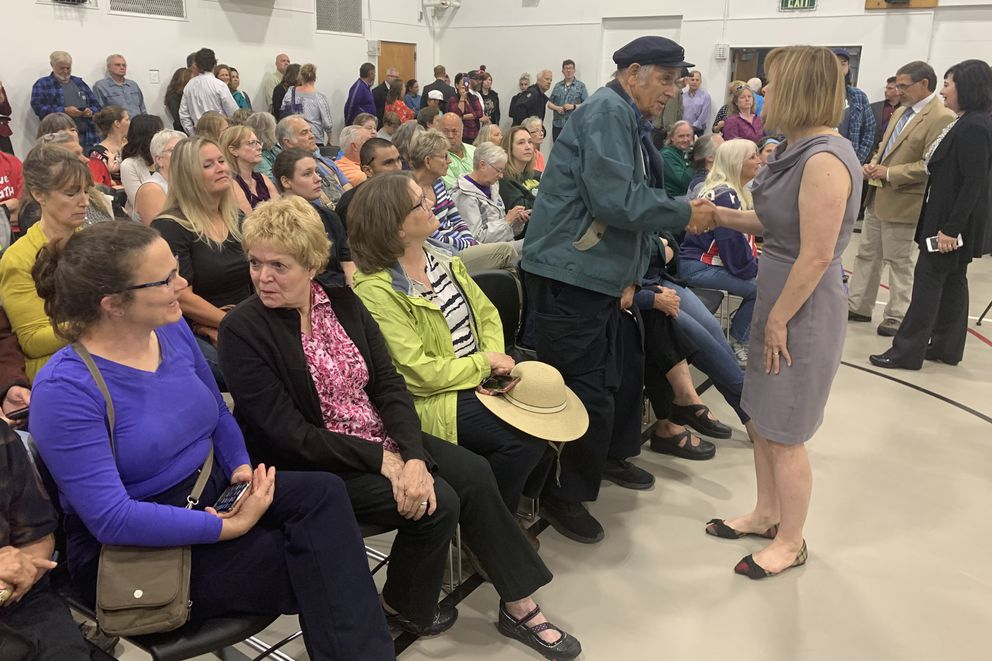 Sen. Mia Costello, R-Anchorage, talks at a brief meeting with four of her colleagues Thursday at Wasilla Middle School. The lawmakers then went into the crowd and spoke with individuals. (Tegan Hanlon / ADN)