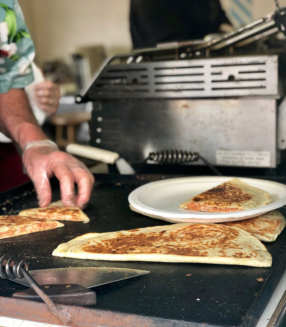 Salmon quesadillas on the grill at Salmon Express at the Alaska State Fair in Palmer, Aug. 25, 2019 (Photo by Samantha Davenport)