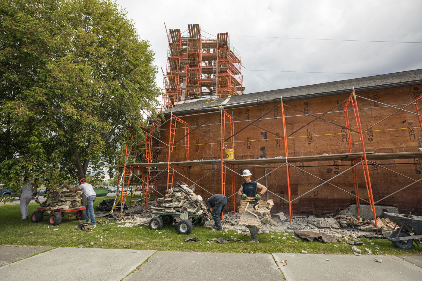 Workers from Superior Plastering and Cement Finishing remove stucco from First Presbyterian Church in downtown Anchorage on Wednesday, June 13, 2019. (Loren Holmes / ADN)