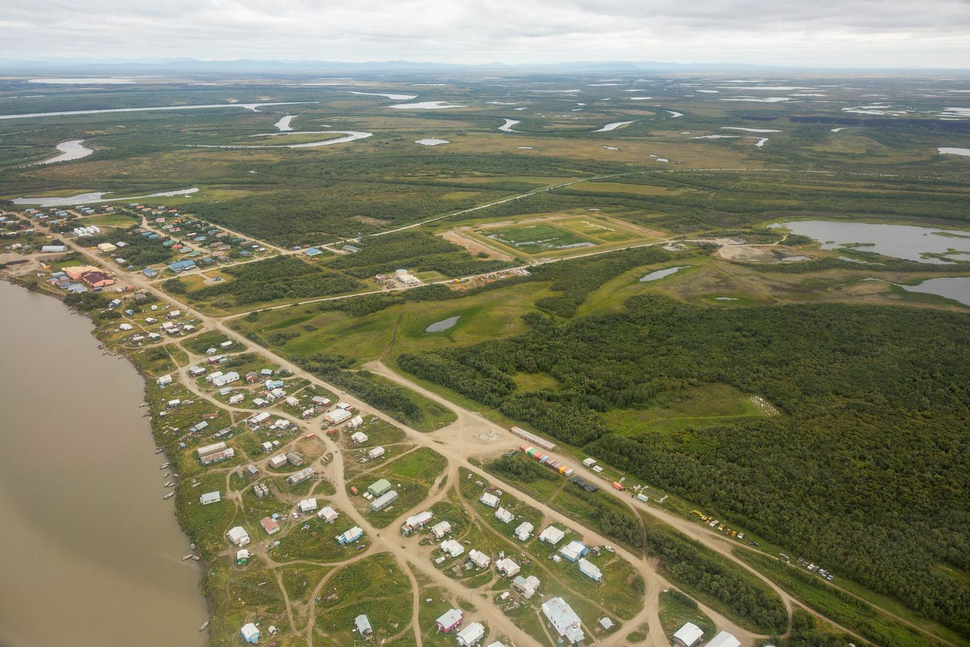 The Kwethluk skate park, visible in the lower center portion of this aerial photo, on Friday, August 7, 2015. The park, which was built with an Indian Health Services grant, is the only one of its kind in a small rural Alaska village. (Loren Holmes / ADN)