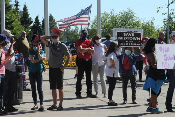 People gather outside the Loussac Library while waiting to attend the Anchorage Assembly meeting on Tuesday, July 14, 2020. Bill Roth / ADN)