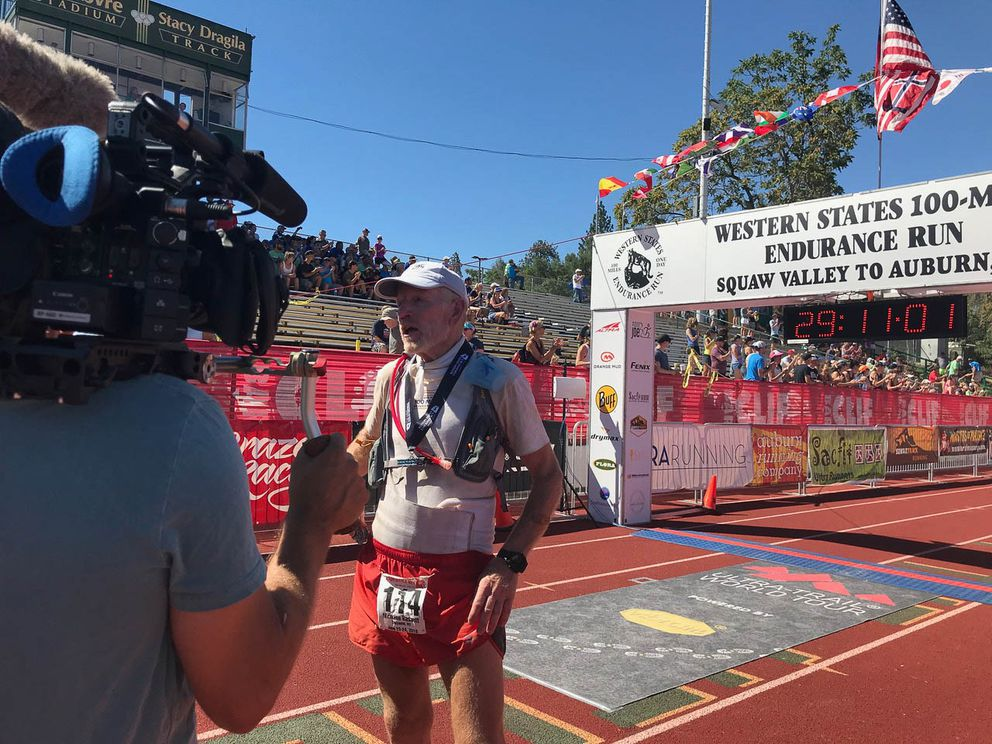 Nick Bassett gives an interview  after crossing the Western States 100 finish line. (Photo by Alysa Horn)
