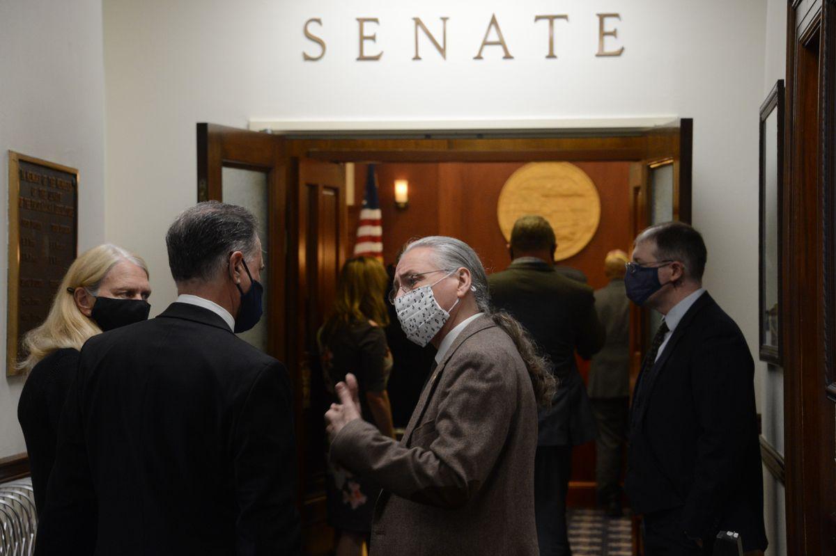 Senate Minority Leader Tom Begich, D-Anchorage (facing camera), talks to Senate President Peter Micciche, R-Soldotna, before a meeting of the Alaska Senate on Wednesday, April 28, 2021. (James Brooks / ADN)