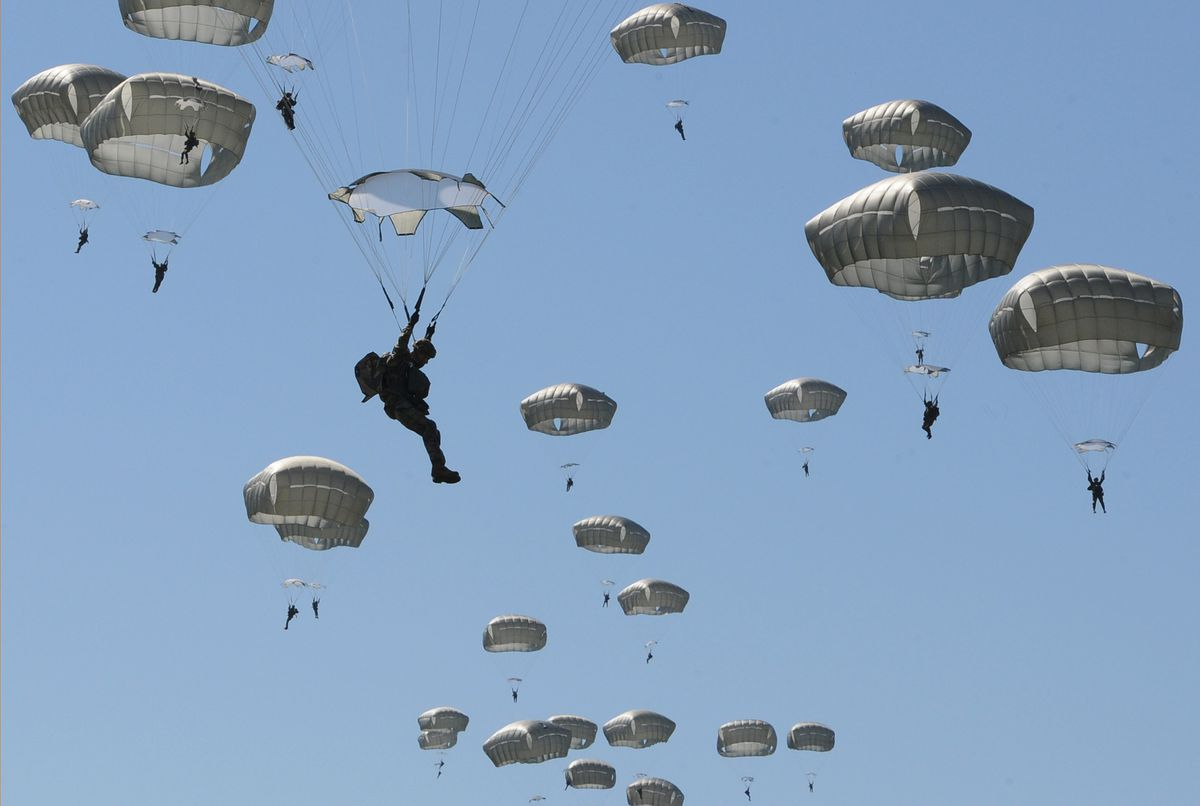 Paratroopers from the 4th Infantry Brigade Combat Team (Airborne), 25th Infantry Division float to the ground at the Malemute Drop Zone on Joint Base Elmendorf-Richardson on Monday, June 10, 2019, while taking part in the joint exercise Arctic Aurora with paratroopers from the 1st Airborne Battalion, 1st Airborne Brigade, Japanese Ground Self-Defense Force. (Bill Roth / ADN)