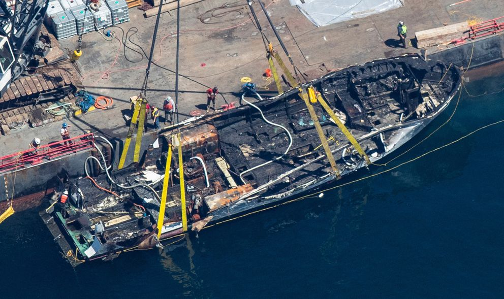 The burned hulk of the Conception is brought to the surface by a salvage team in the Santa Barbara Channel off of Santa Cruz Island, California, on Sept. 12, 2019. (Brian van der Brug/Los Angeles Times/TNS)