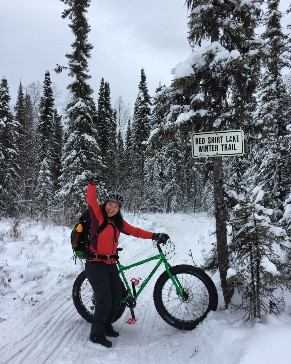Vicky Ho dances to help ease the pain of riding a fat-tire bike as a novice on a trip to a cabin at Red Shirt Lake on Sunday. (Suzanna Caldwell)