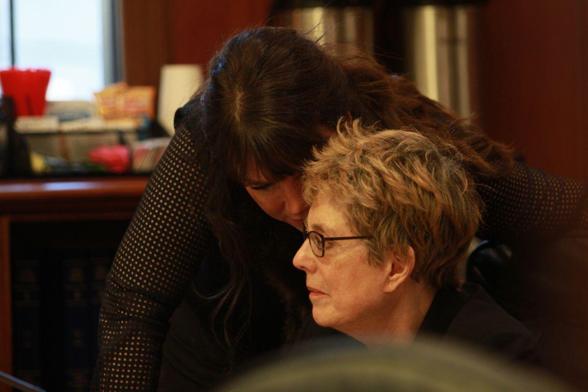Rep. Charisse Millett whispers to Rep. Gabrielle LeDoux during a break from the Alaska House's floor debateSaturday. Millett and LeDoux, both Anchorage Republicans, support reversing major elements of last year's major criminal justice overhaul legislation, Senate Bill 91. (Nathaniel Herz / Alaska Dispatch News)