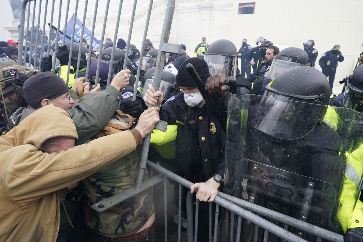 Protesters attempt to force their way through a police barricade in front of the U.S. Capitol as Congress worked Wednesday, Jan. 6, 2021, to finalize the Electoral College votes in Washington, D.C. (Kent Nishimura / Los Angeles Times/TNS)