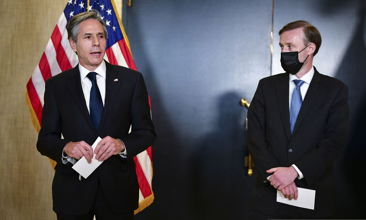 Secretary of State Antony Blinken, accompanied by National Security Adviser Jake Sullivan, right, talks to the media after a closed-door morning session of US-China talks in Anchorage on Friday. (Frederic J. Brown / Pool via AP)
