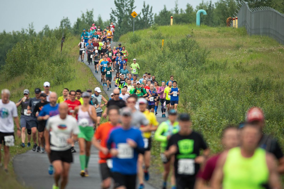 f69e96d1abbe7a Runners compete in the Mayor s Midnight Sun Marathon on Saturday. (Loren  Holmes   ADN
