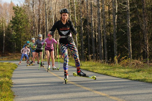 APU skiers roller ski along the bike trial in Kincaid Park on Wednesday, Oct 17, 2018 in Anchorage, AK. (Bob Hallinen / ADN)