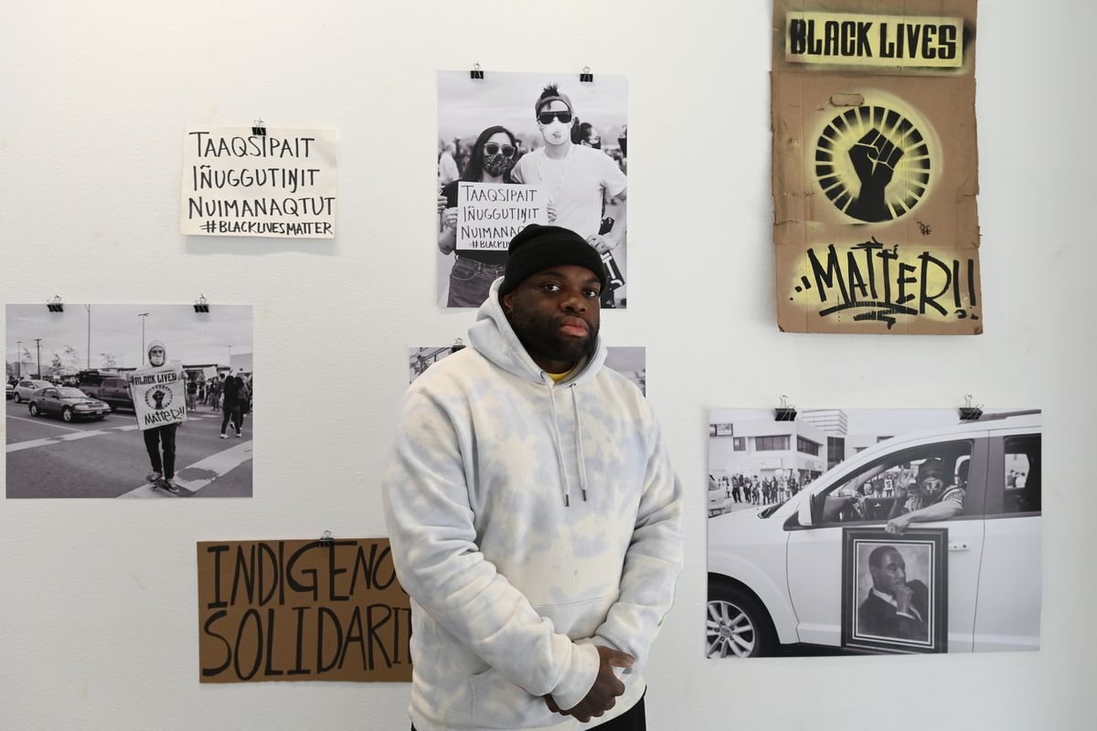 Jovell Rennie, co-owner and co-founder of Akela Space, a gallery and community studio on Sixth Avenue, with an exhibit by local photographers from both rallies against police brutality in Anchorage on May 30. (Bill Roth / ADN)