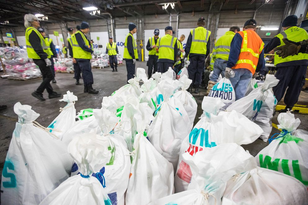 Musher drop bags wait to be weighed and sorted Thursday, Feb. 15, 2018 at Air Land Transport in Anchorage. (Loren Holmes / ADN)
