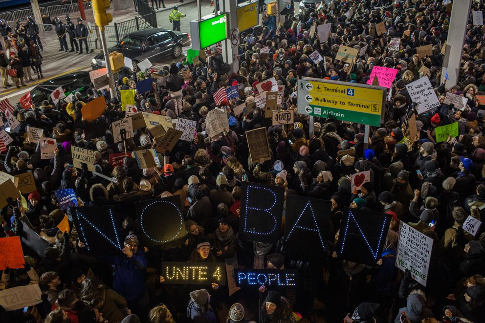 Demonstrators protest the Trump administration's travel ban at Kennedy International in New York, Jan. 28, 2017. (Christopher Lee/The New York Times file)
